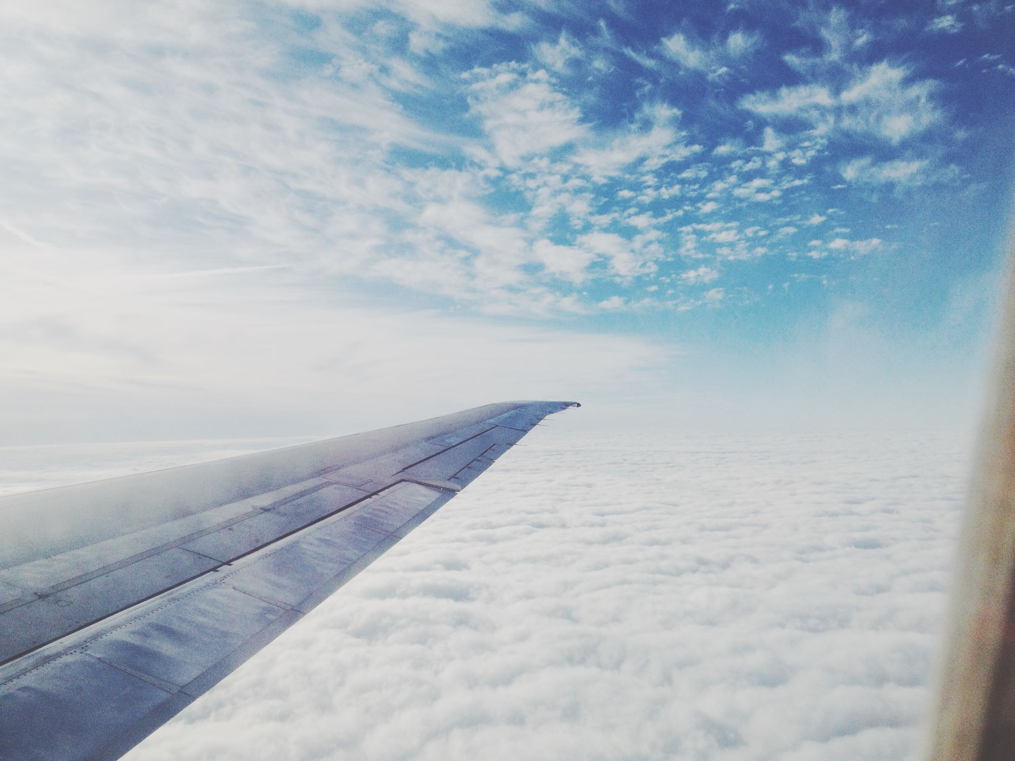 airplane window - best websites to find cheap flights