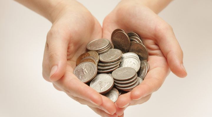 Silver coins in hands