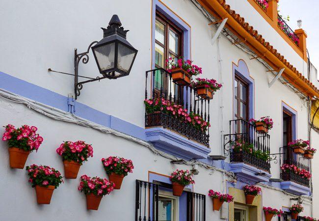 Hanging flower pots in La Juderia in Cordoba Spain