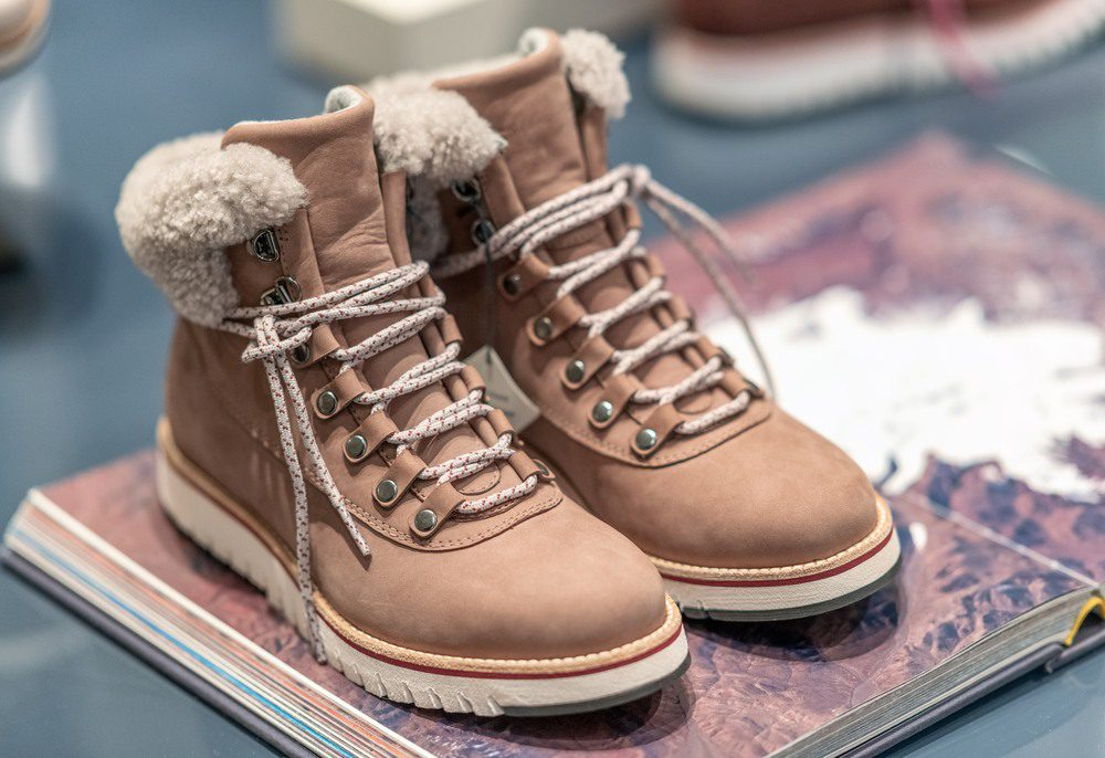 Pair of winter shoes in a shop showcase
