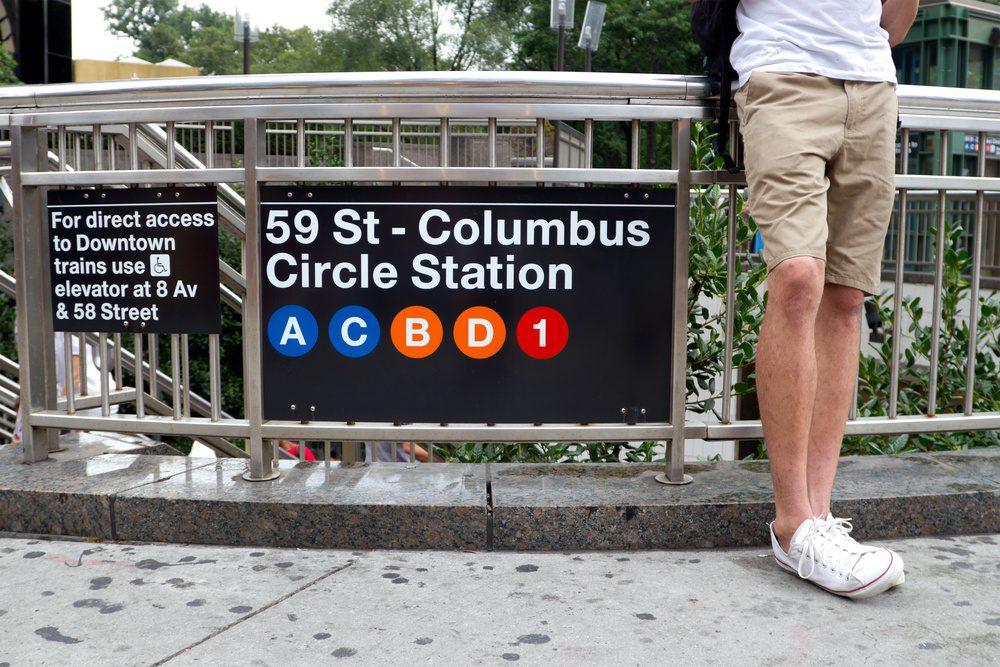 Man standing and waiting at the 59th street - Columbus Circle subway station, Manhattan, New York